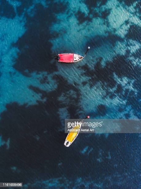two colourful boats moored at sea, wales, united kingdom - 南西 ストックフォトと画像