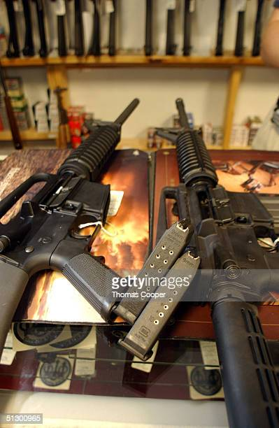Two Colt AR15's both now legal sit on the counter of Dave's Guns September 13 2004 in Denver Colorado The weapon on the right has a bayonet mount...