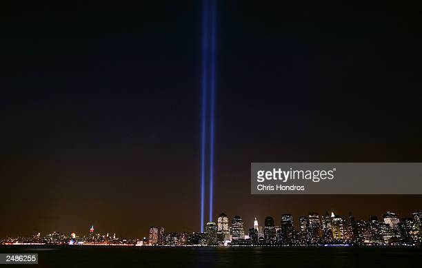 Two columns of light symbolize the fallen World Trade Center towers in a tribute in light as seen from New Jersey September 11 2003 in New York City...