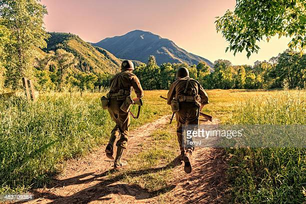two combat soldiers take off running across open field - charging sports stock photos and pictures