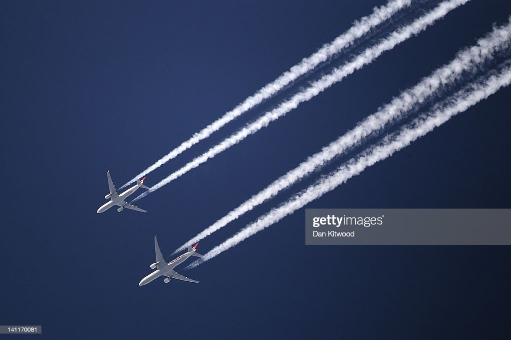 Two commercial airliners appear to fly close together as the pass over London on March 12, 2012 in London, England.