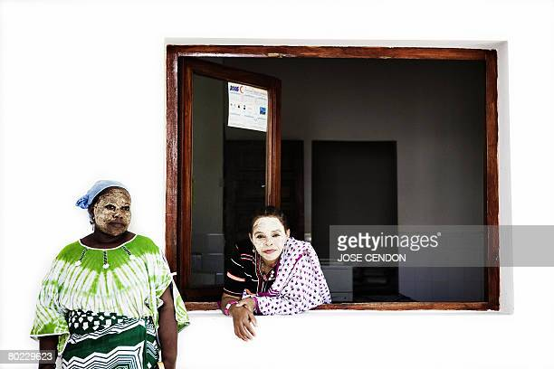 Two Comoran women are photographed at the Presidential Palace 13 March 2008 in Ouani near Mutsamudu the capital of Anjouan As the African Union...