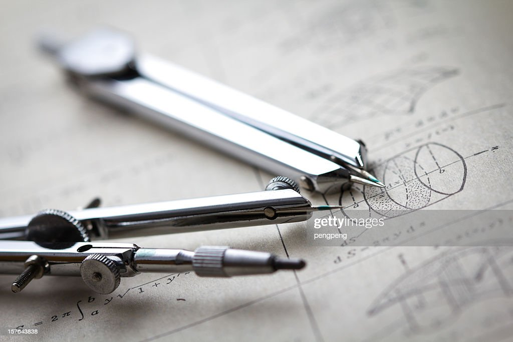 Two compasses on a math worksheet : Stock Photo