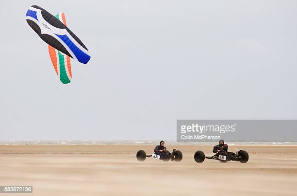 Two competitors taking part in one of the races at the European Kite Buggy Championships at Hoylake Wirral north west England Around 75 buggies with...