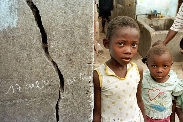 two congolese children who recently returned to brazzaville stand