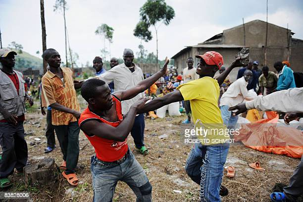 Two Congolese men fight each other over an argument that flared up while a Non Governmental agency was distributing food aid near a camp for...