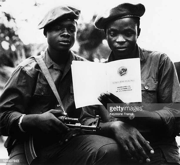Two Congolese soldiers reading President MAO's LITTLE RED BOOK in December 1966 distributed in Africa by Chinese Communists