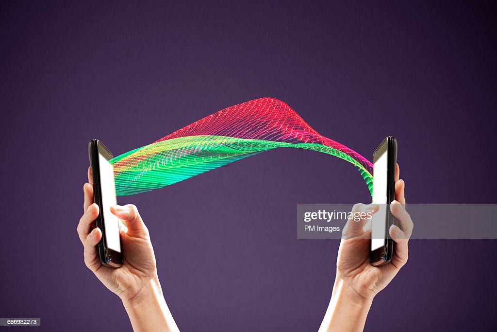 Two connected smart phones : Stock Photo