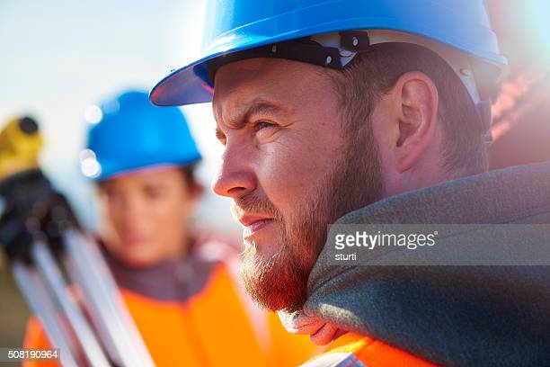 two construction site surveyors