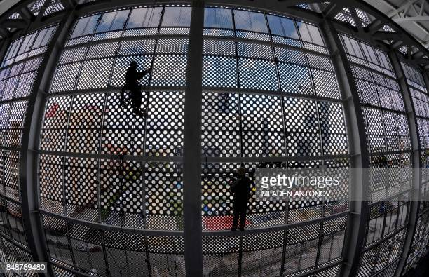 TOPSHOT Two construction workers climb on the metal structure of the Yekaterinburg Arena in Yekaterinburg on September 18 2017 Yekaterinburg Arena...