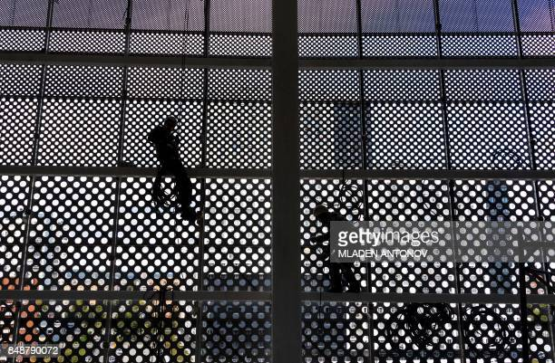 Two construction workers climb on the metal structure of the Yekaterinburg Arena in Yekaterinburg on September 18 2017 Yekaterinburg Arena will host...