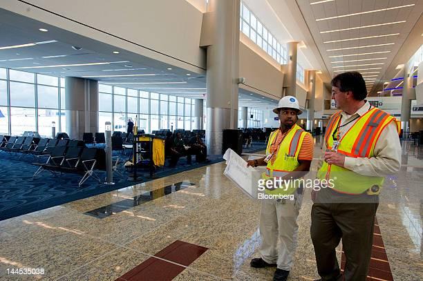 Two construction workers review final plans at the Maynard H Jackson Jr International Terminal at HartsfieldJackson International Airport in Atlanta...