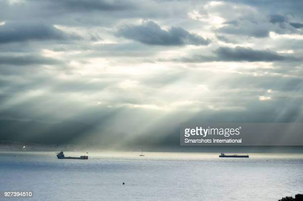 two container ships amidst bad weather under dramatic sky in genoa, italy - calm before the storm stock pictures, royalty-free photos & images