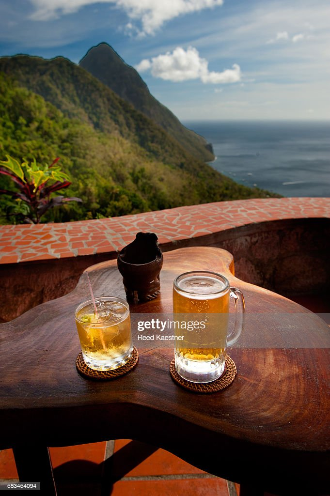 Two cool drinks await vacationers over looking the Pitons of St Lucia. : Stock Photo