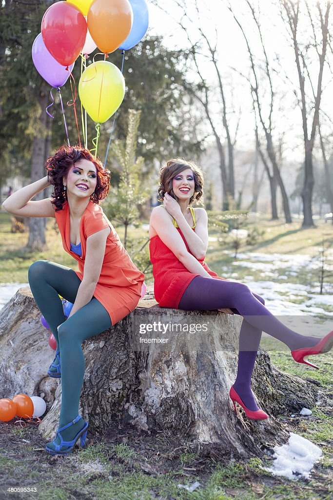 Two coom fashion women at park : Stock Photo