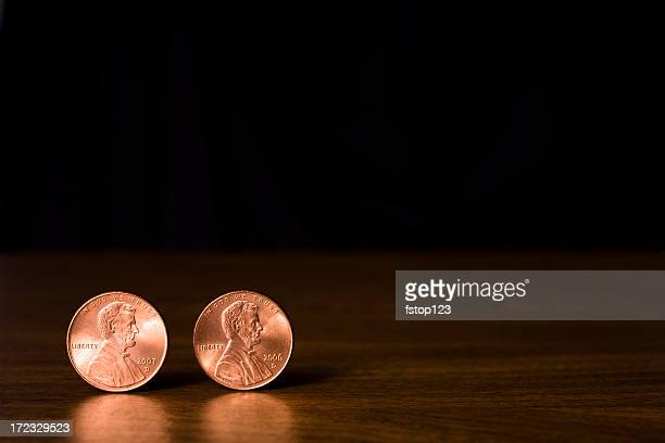 two copper lincoln head pennies against black background - us penny stock pictures, royalty-free photos & images