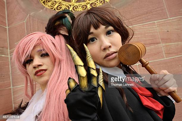 Two 'Cosplayer' pose at the 'Frankfurter Buchmesse' on October 12 2014 in Frankfurt am Main Germany Cosplay is a contraction of the words 'costume'...
