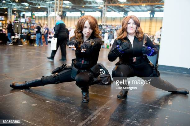 Two cosplayers both in character as Black Widow from The Avengers at The Birmingham Film and Comic Con Collectormaina 24 at NEC Arena on June 4 2017...