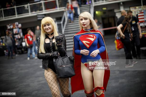 Two cosplayers dressed as Blackcat and Supergirl attend London Super Comic Convention at Business Design Centre in Islington London on August 26 2017...