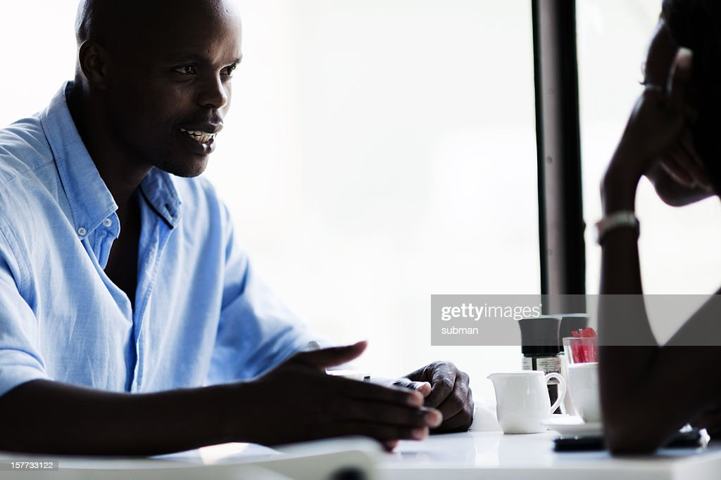 Two couples arguing in cafe : Stock Photo