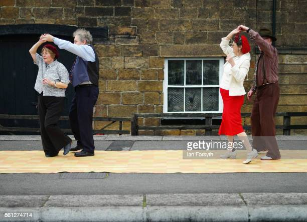 Two couples dance on the platform at Grosmont station during the North Yorkshire Moors Railway 1940's Wartime Weekend event on October 14 2017 in...