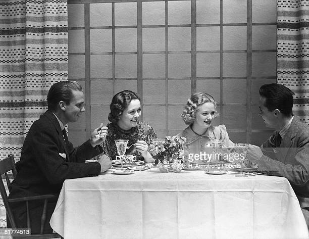 Two couples dining in club restaurant.
