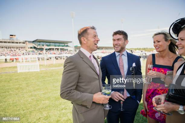 two couples enjoying a drink - newcastle races stock photos and pictures