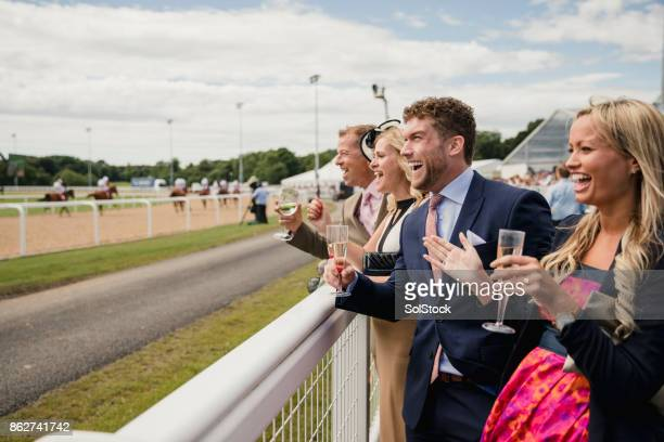 two couples enjoying a drink - horse racing stock pictures, royalty-free photos & images