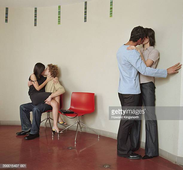 two couples kissing indoors - heteroseksueel koppel stockfoto's en -beelden