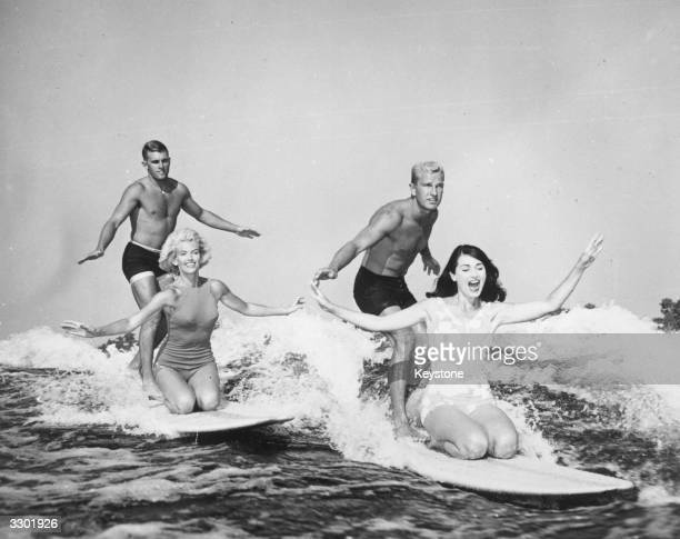 Two couples lake surfboarding in Cypress Gardens Florida