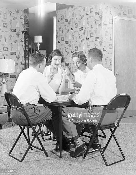 two couples playing bridge around card table. (photo by h. armstrong roberts/retrofile/getty images) - bridge card game photos et images de collection