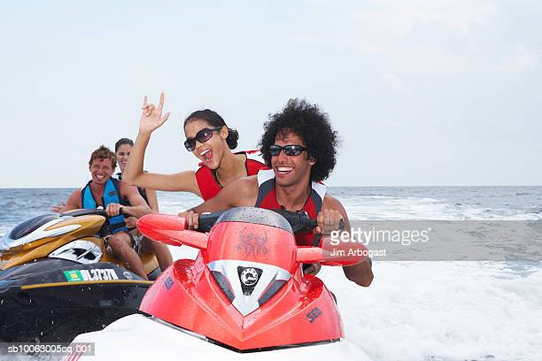 Two couples riding jet boats