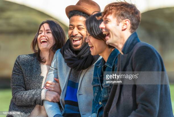 two couples sharing a joke - ile de france stock pictures, royalty-free photos & images