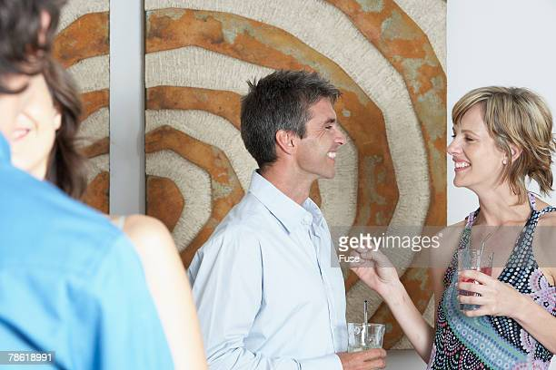 Two Couples Talking at Party