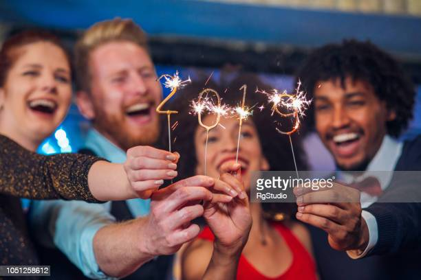 two couples with sparklers - 2019 stock pictures, royalty-free photos & images