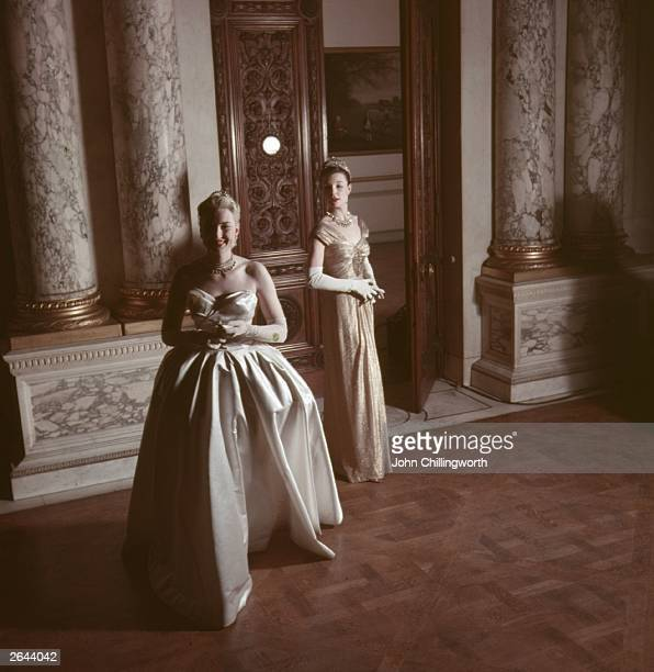 Two court dresses from Norman Hartnell's 'Gold and White' collection of peeresses' dresses designed for the coronation of Queen Elizabeth II The gold...