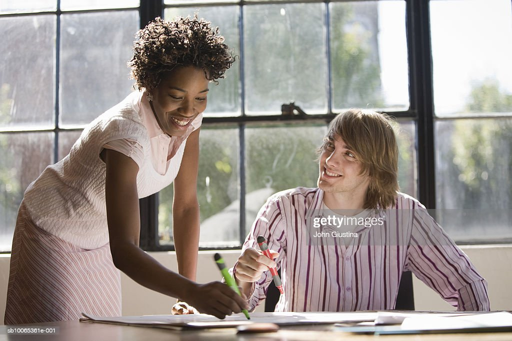 Two co-workers brainstorming over ideas : Foto stock