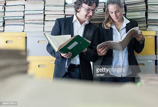 Two Coworkers Looking at Paperwork in the Office