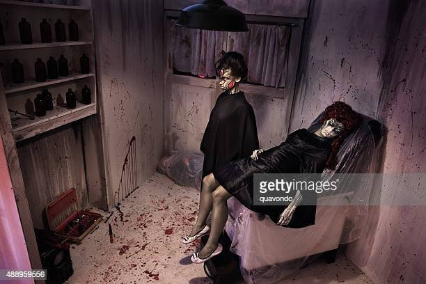 two creepy girls in a bloody room - dead girl stock pictures, royalty-free photos & images