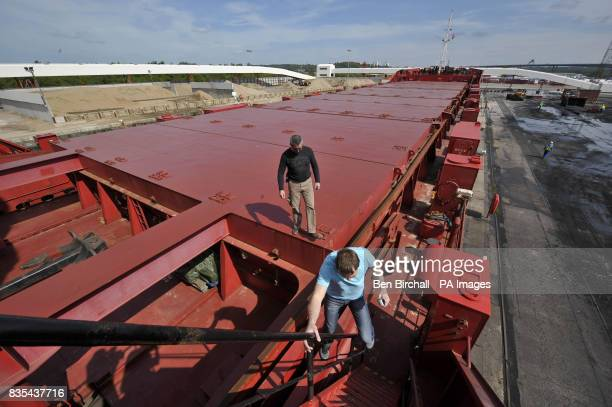 Two crew members aboard the empty deck of the OMG Kolpino Russian cargo ship pictured at Avonmouth docks Bristol where its crew of 12 sailors has...