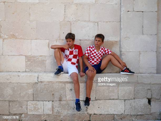 Two Croatian boys are seen in sorrow Croatians in the Island of Pag watched the world cup football final match Croatia vs France Croatia lost 24 but...