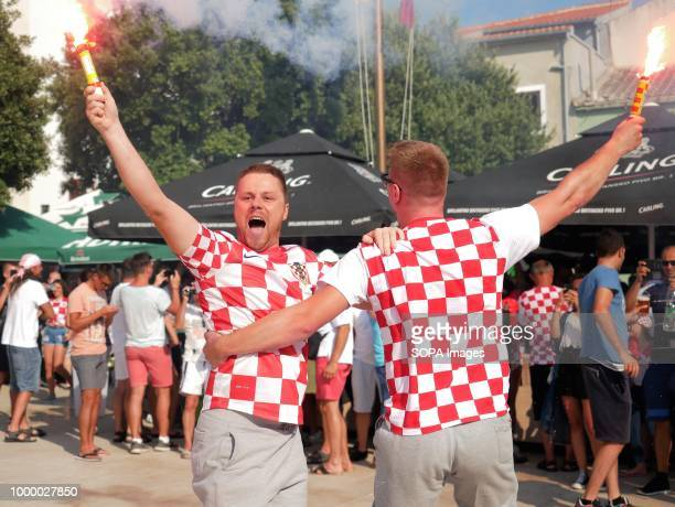 Two Croatian men are seen celebrating Croatians in the Island of Pag watched the world cup football final match Croatia vs France Croatia lost 24 but...