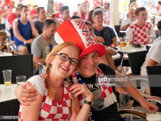 Two Croatian women are seen smiling Croatians in the Island of Pag watched the world cup football final match Croatia vs France Croatia lost 24 but...