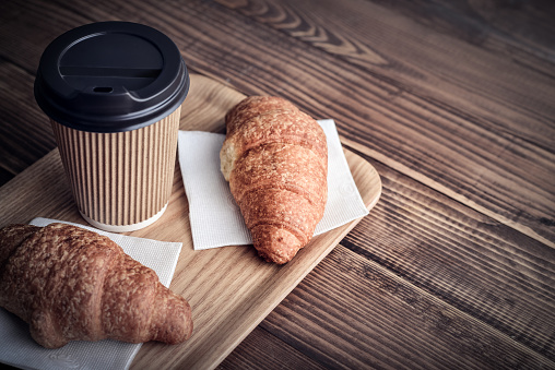 Two croissants and coffee-to-go 1000088424