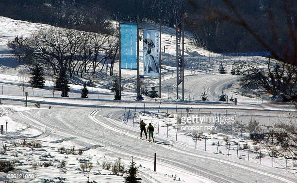 Two cross country skiers practice at Soldier Hollow site of Cross Country events for the 2002 Winter Olympics 30 January 2002 in Miway Utah AFP...