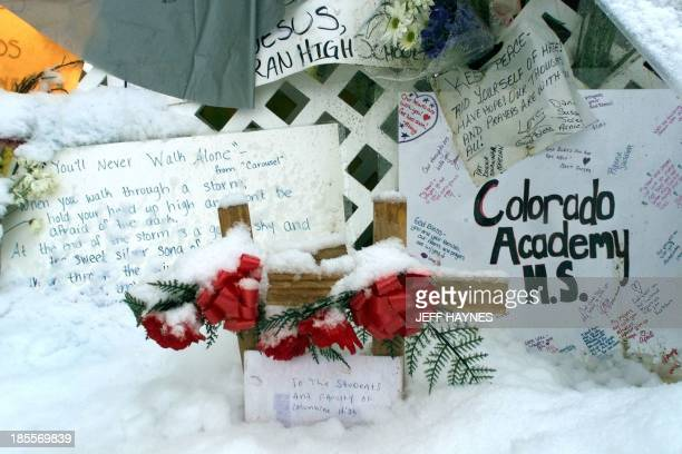 Two crosses are covered in snow at a makeshift memorial in a park 23 April 1999 next to Columbine High School in Littleton CO where fourteen students...