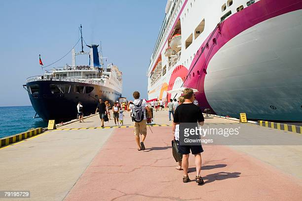 two cruise ships moored at a harbor, ephesus, turkey - passagier wasserfahrzeug stock-fotos und bilder
