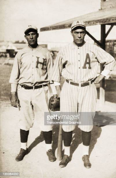 Two Cuban baseball stars both players in the US Major Leagues pose in Almendares Park before a game circa 1920 in Havana Cuba