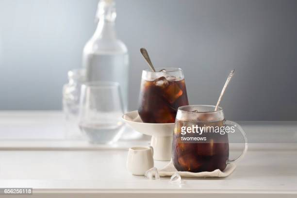 two cup of iced black coffee. - iced coffee stock pictures, royalty-free photos & images
