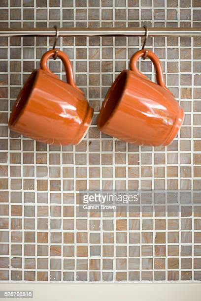 Two Cups in Front of Wall